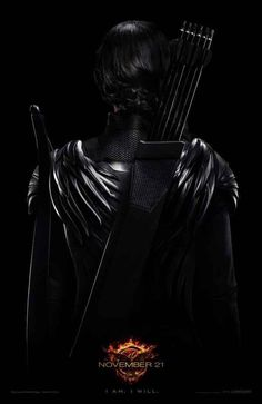 "There's a brand-new poster for The Hunger Games: Mockingjay — Part 1 and it provides another peak at Katniss (Jennifer Lawrence) in the franchise's third film, due out Nov. 21. | Katniss Goes Dark In The Latest ""Mockingjay"" Poster"