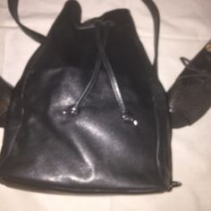 👛👛Great Vintage Leather Bag NWOT 👛👛 This is a great vintage leather bag. This bag can be used in several ways, handle, cross body, or shoulder. It has a drawstring like a hobo bag and a snap like a regular bag. The strap is detachable. The strap can be attached at the top or attached on the side as seen in the pictures. All leather. NWOT! Bags