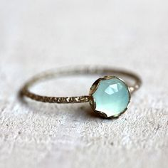 Aqua blue chalcedony gemstone ring. A brilliant and stunning rose cut blue chalcedony gemstone sits atop a patterned sterling silver band. Set is a scalloped sterling silver setting. PLEASE NOTE THAT