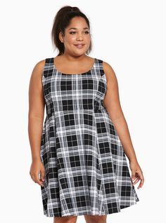 """Good vibes are cool but plaid vibes are better (we've got an attitude problem, deal with it). The schools-out-forever textured black and white plaid print is swingy thanks to a pleated paneled seams. The slight scoop lets you flash a hint of skin.<div><ul><li style=""""LIST-STYLE-POSITION: outside !important; LIST-STYLE-TYPE: disc !important"""">Size 1 measures 39 1/4"""" from shoulder</li><li style=""""LIST-STYLE-POSITION: outside !important; LIST-STYLE-TYPE: disc !important"""">Polyester/spandex</li><li…"""