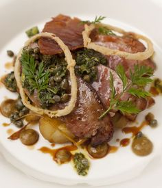 Calf's liver with sage salsa verde, caper, raisins, potatoes and crispy ham recipe - James Durrant's calf's liver recipe includes a host of comforting accompaniments, including a sweet and tangy date and caper purée, sage salsa verde and gloriously crispy onion rings.