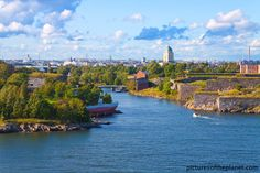Great landscape photograph of Suomenlinna fortress and the Finland capital of Helsinki in the distance.