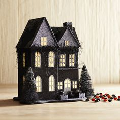 Beautiful architecture and landscaping can't hide the creepy vibe that emanates from our Tudor mansion. Hand-painted and pre-lit from within, it will do its glittery best to set a spooky tone on your entryway or buffet table. CAUTION: You probably shouldn't tell your guests who—or what—lives within its walls. Right?