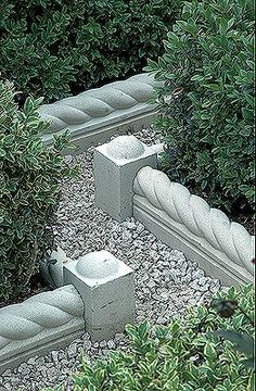 Roped Edging Stones  love this idea! so much more beautiful than treated wood or black plastic!