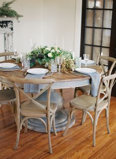 once wed wedding table seating ideas round wedding table soft blue accents rustic wood theme botanical wedding inspiration Dining Room Design, Dining Room Table, Table Bench, Farmhouse Round Dining Table, Dining Rooms, Wedding Table Seating, Wedding Chairs, Rustic Chair, Rustic Wood