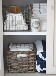Honeycomb Creative Co.: The Linen Closet {Small Space Storage}  One project on my list is to separate standard pillow cases and queen king cases. Love this idea of baskets or wire containers. Can label them keep that space tidy!