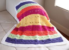 This pretty blanket features an easy-to-memorize stitch pattern that works up quickly.