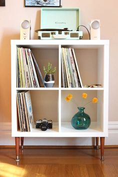 An IKEA Kallax shelf is the perfect height for storing vinyl records. Add some legs and it's a beautiful piece of furniture for your home! Ikea Hack, Ikea Furniture, Decor, Apartment Decor, Ikea Upgrades, Ikea Kallax Shelf, Home, Home Diy, Diy Furniture