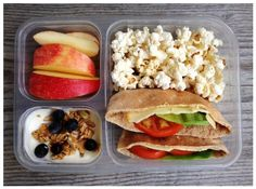 Good Thursday morning...this is my 1st grader's lunch today: Whole-wheat pitas filled with hummus/cheese/lettuce/tomato, popcorn (microwaved in a brown paper lunch bag), apple slices, and plain yogurt mixed with a little pure maple syrup, vanilla, homemade granola and blueberries. The details are below.