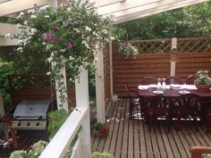 Terrace. Flowers. Grill. Our home! Love it.