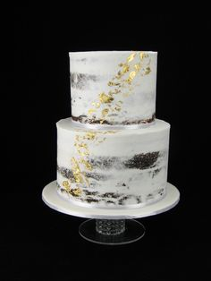 Semi-naked chocolate mud cake with buttercream and a splash of real gold leaf (edible) for a gold themed baby shower.