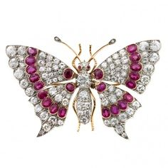 A late Victorian ruby and diamond brooch in the form of a butterfly, with the wings set en tremblant, total diamond weight estimated 14 carats, total rubies weight estimated 12 carats, to a silver and yellow gold mount, gross weight 23.8 grams, see John Sheldon sale catalogue lot 375, circa 1860
