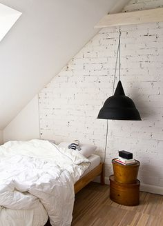 love the brick wall, slanted ceiling, and fluffy comforter!