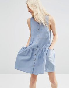 Buy it now. ASOS Sleeveless Button Through Smock Dress - Blue. Dress by ASOS Collection, Non-stretch denim, Unlined design, Scoop neckline, Front button placket, Chest pocket detail, Dropped armholes, Functional side pockets, Relaxed fit, Machine wash, 100% Cotton, Our model wears a UK 8/EU 36/US 4 and is 175cm/5'9 tall. ABOUT ASOS COLLECTION Score a wardrobe win no matter the dress code with our ASOS Collection own-label collection. From polished prom to the after party, our London-based…