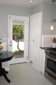 1940's Cottage Kitchen, 1940' Cottage kitchen on a budget., A view to the back yard.     , Kitchens Design