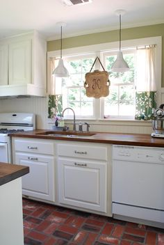 Love everything about this kitchen. The butcher block counter top, the brick flooring, even the trim all the way around the walls. Only cost them $1440.00 but they did some things I wouldn't have.