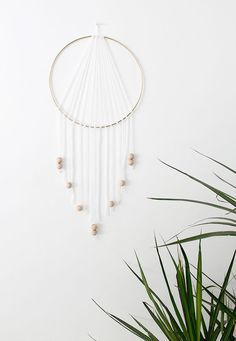 If you love the delicate, boho style of a dreamcatcher, here are 10  tutorials for you to try to make your own!