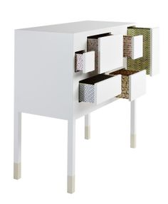 aLL white with patterned inside sides of drawers..