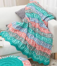 Free Knitting Pattern for Mosaic Squares Throw - This colorful afghan is knit flat in sections of Zigzag Garter Stitch, Divider, and Mosaic Square patterns.Designed by Heather Lodinksy for Red Heart.Throw measures about 56 x 56″[142 x 142 cm].