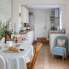 pretty blue kitchen, light white, wooden floor