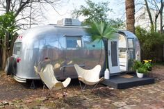 """Ann, the vintage Airstream, currently lives in a New Orleans backyard. Its owner Jill Dupre named it after her grandmother; she remembers her grandfather saying, """"Let's hit the road, Ann"""" whenever they were ready to go. Airstream Bambi, Airstream Remodel, Airstream Renovation, Airstream Interior, Vintage Airstream, Airstream Trailers, Vintage Travel Trailers, Vintage Motorhome, Cafe Interior"""
