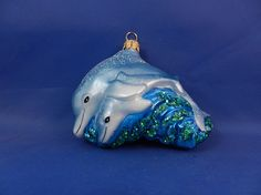 Pair of Dolphins swimming in the Ocean. Blown glass Christmas ornament.