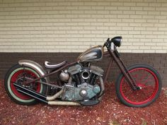 Rat rod with red wheels and a bobber tank. #Motorcycle
