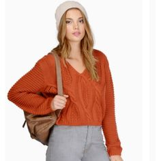 Tobi Laced Up Sweater Super cozy rust colored Tobi sweater. Knit detailing in front with a laced up back. Does have some fraying on the bottom of the right sleeve but that's hardly noticeable. Color a bit darker than pictured. True rust colored. Perfect for fall! Tobi Sweaters V-Necks