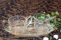 This lovely glass cream and sugar set have a nice sturdy weight.