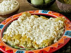 Green Chicken Enchiladas 1-12 oz. Ranchero® Queso Fresco cheese ½-5 oz Cotija, crumbled 3 chicken brsts, shredded 12 corn tortillas 2 c green enchilada sauce ½ c cilantro, chop 1 can gr chilis 350°-Mix chicken, chilies, ½ Fresco, Cotija and 4T sauce. Spoon chicken mixture and cheese mixture on tortilla. Roll and cover enchiladas with sauce bake 15-20 minutes. Top with cheese. Bake 5-7 minutes or until cheese starts to brown.