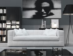 Nella Vetrina, Italian designer sofa handmade and shown in white leather with chrome metal base. This luxury Italian furniture collection features a wide selection of finishes including fabric and leather. Samples available upon request. Made in Italy.