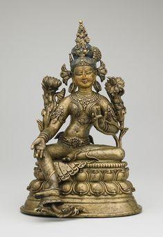 A central Tibetan gilt copper alloy figure representing Green Tara, making a blessing mudra. (Rubin Museum)