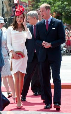 Part Deux, Part Deux: And another rewear—this time, the white Reiss dress that Middleton wore to her engagement photo shoot. She topped it off with a Canada-red, Sylvia Fletcher maple-leaf hat. By Mark Large/Pool/Getty Images.