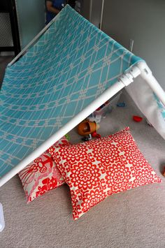 Homemade triangle tent idea for over the bed