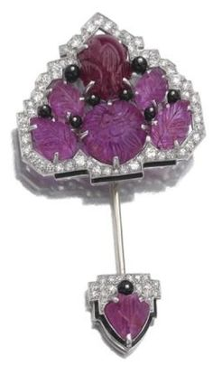 made by Cartier is set with carved rubies, onix and diamonds.