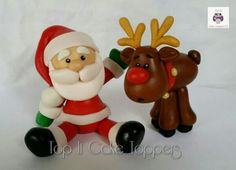 Christmas cake topper. Santa and Rudolph cake topper. Made with marshmallow fondant