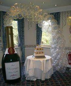 Champagne Bottle Balloon Arch - Make your wedding cake table look extra special with this balloon decoration! Balloon Columns, Balloon Garland, Balloon Arch, Balloon Decorations, Birthday Decorations, Wedding Decorations, Champagne Balloons, Champagne Party, Confetti Balloons