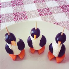 Three penguins (2 olives, 1 carrot and a little bit of philadelphia cheese for each one)