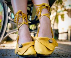 Yellow tie up flats