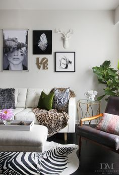 White Leather Sofa with zebra, art wall, fiddle leaf fig, lucite ottoman, danish chair