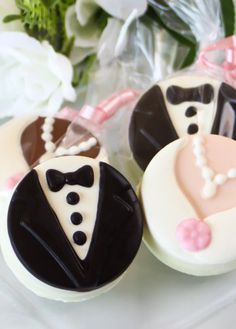 Celebrate the happy couple with these bride and groom chocolate covered Oreo cookies. Each Oreo cookie is coated in a chocolate design to resemble a bride and groom.