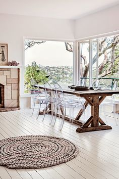 rustic dining room table and modern clear acrylic chairs
