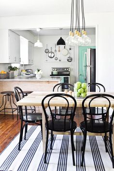 Dining room makeover featuring our City Chandelier 7   via @abeautifulmess   Schoolhouse lighting