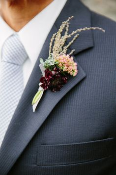 Simple floral boutonniere for the groom