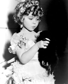 Shirley Temple behind the scenes of The Little Colonel, 1935.