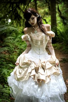 As The World Falls Down - Corseted steampunk gown in ivory and white. Belle inspiration