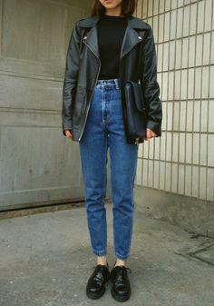 Waved denim: black shoes, blue high waisted jeans, black blouse, black handbag and leather over-sized jacket