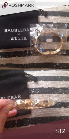 Baublebar x Stila Limited Edition Bracelet this gold tone stretchy bracelet has both metallic and jeweled spikes. Really cute and limited edition collaboration. Never used or opened. Dustbag included. Stila Jewelry Bracelets