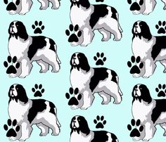 Landseer Newfoundland dog with paw prints fabric by dogdaze  on Spoonflower  - custom fabric Custom Fabric 8e434afa4fe7