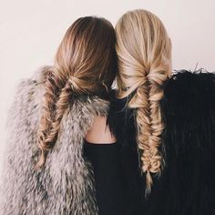 Romantic fish-tail braids are a chic way to tame thick hair.